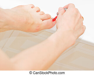 Nailcare - While applying the polish to toenails