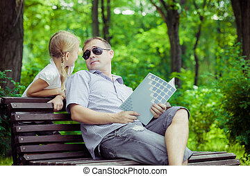 Father and son playing at the park on bench at the day time....