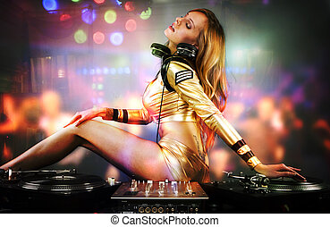 Beautiful DJ girl on decks on the party, - Beautiful DJ girl...