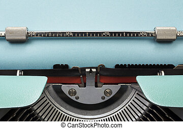 Vintage Typewriter With Empty Blue Paper Sheet