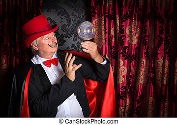 Floating crystal ball and magician - Senior magician...