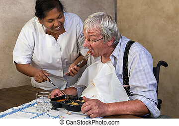 Nurse helping old man - Nurse in old people's home trying to...