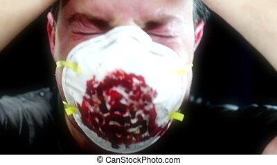 Horror man in bloody breathing mask