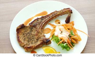 grilled pork chop steak with salad - Video of grilled pork...