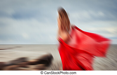 blurred nude woman with red fabric - Abstract image of...