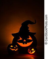 Three jack-o-Lantern at dark background