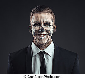 Portrait laughing businessman with makeup skeleton