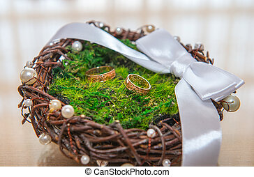 gold wedding rings on a basket in the registry office
