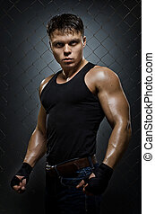 street-fighter - vertical photo muscular young guy...