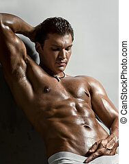 sexy man - the very muscular handsome sexy guy on grey...