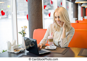 young woman in Cafe - Very beautiful, happy, young woman,...