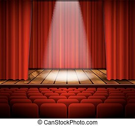 A theater stage with a red curtain