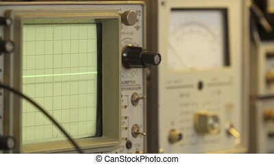 Electronics technician oscilloscope close up