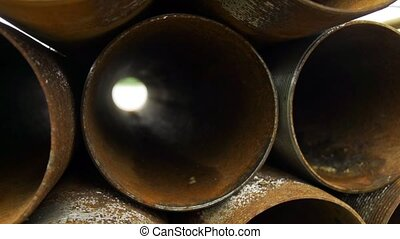 Corroded casing pipes close up pan