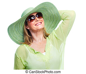 Happy senior woman in hat and sunglasses.