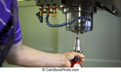 The installing tool into cnc machine close-up