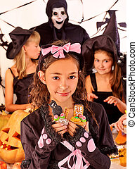 Halloween party with children holding trick or treat -...