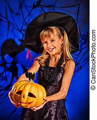Witch child at Halloween party.