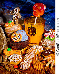 Halloween table with trick or treat. Holiday drink