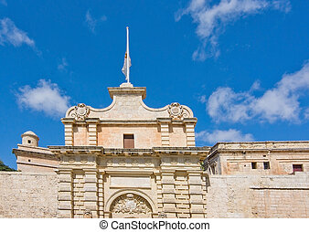 Mdina - Baroque building with flag surrounded by old city...