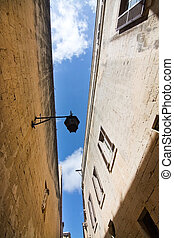 Mdina - Old buildings and blue sky inside old city walls on...