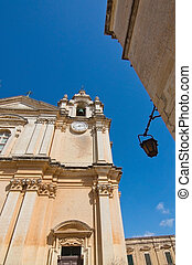 Mdina - Old buildings, street lamp and blue sky inside old...