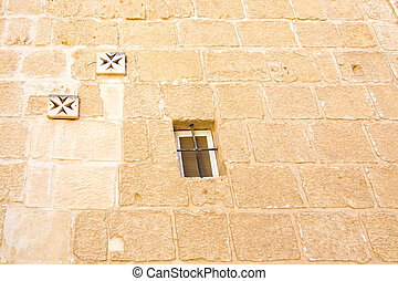 Mdina - Maltese cross wall decorations and window on old...