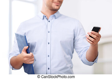 Professional realtor holding folder - Busy at work. Pleasant...