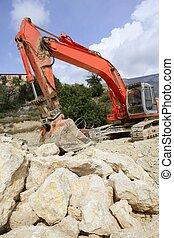 Backhoe bulldozer working hard with stones