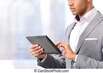 Handsome businessman holding laptop - Surf the Internet...