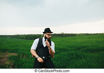 man with a beard, thinking in the field - Man with a beard...