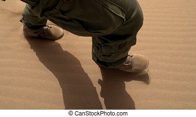 Patrolling Desert - Movement of the legs in the army gear on...