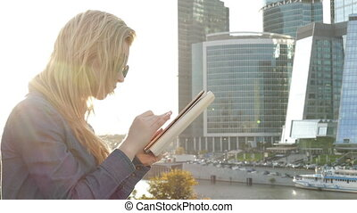 woman using tablet computer - woman blonde using tablet...