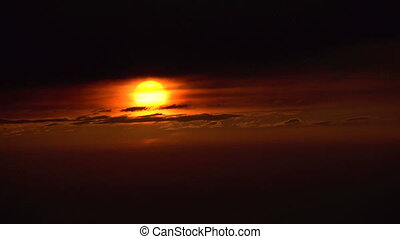 Sun Goes Below the Horizon - Red sun quickly goes down...
