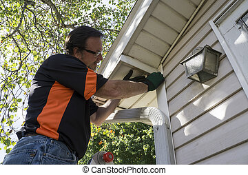 Contractor Fixing Vinyl Siding For Customer - Contractor...