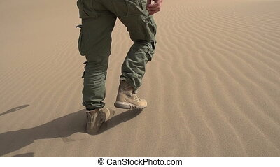 Infantryman is Moving on the Sand - Movement of the legs in...