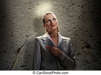 Saint businesswoman - Young saint businesswoman with light...