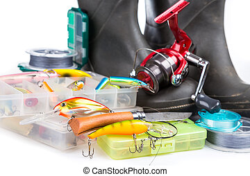 fishing tackles and rubber boots on white background for...