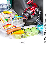 fishing tackles and rubber boots on white background. for...