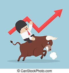 Businessman riding on bull, Bullish stock market concept,...