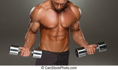 athletic man bodybuilder doing exercises with dumbbell -...