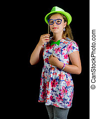 Pretty uoyng teenager in green hat. Studio photo