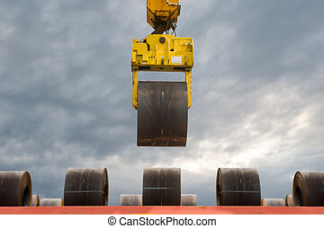Steel Coils Handling - An overhead crane carrying a steel...