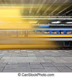 Arriving train - Train arriving at a platform, leaving a...