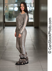 Beautiful Woman Wearing Fashion Track Suit In Red -...
