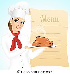 smiling female chef with christmas roasted turkey