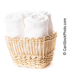 White towels - White spa towels in a basket isolated Spa...
