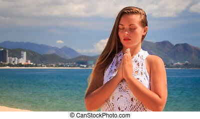 blonde girl in lace meditates in yoga asana standing -...