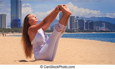 blonde girl demonstrates yoga asana full boat - blonde girl...