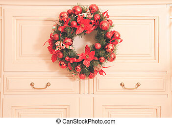 Home decor - Christmas wreath on the furniture in the room....